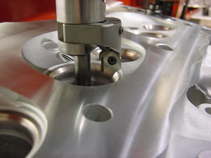 Valve seat cutting on a V8 cylinder head